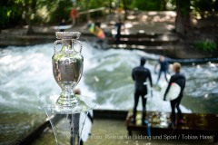 UEFA EURO 2020 Trophy in front of surfers at Eisbachwelle in Munich. Munich, Germany 28.05.2021