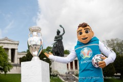 UEFA EURO 2020 mascot Skillzy with the UEFA EURO 2020 Trophy in front of the Bavaria monument at Theresienwiese in Munich. Munich, Germany 28.05.2021