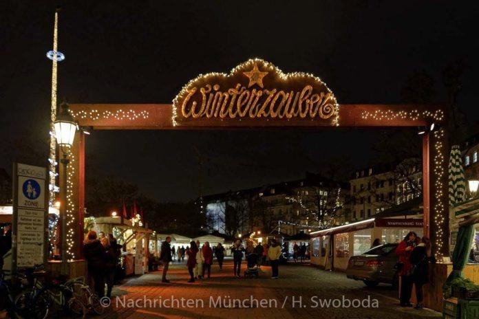 """Traditionelles """"Anleuchten"""" - Winterzauber auf dem Viktualienmarkt"""