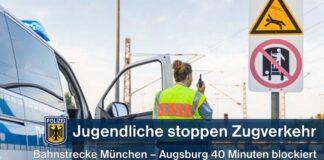 Jugendliche im Gleis stoppen Bahnverkehr